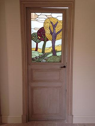 Une porte avec paysage